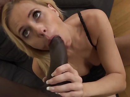 Mature blonde woman is sucking a big, malicious dick and getting it inside her pussy
